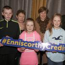 Donard NS who finished third in the Under 13 section at the Credit Union Schools Quiz in the Riverside Park Hotel. Front: Cormac Kenny, Phena Quigley, Brídín Quigley and Shayne McDonald. Back: Frances Cross (ECU), Roisin Quigley (parent) and Nicky Cosgrave (chairman ECU)