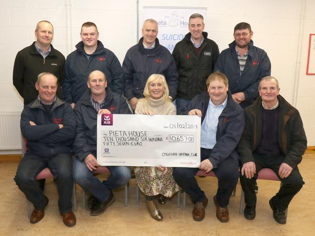 Oylegate Vintage Club committee presenting a cheque for €10,657, proceeds of Light Up The Night Run, to Pieta House in Oylegate Community Centre. Back: Tommy Cosgrave, John Kehoe, Cormac Downes, Damien Finn and Ger Kehoe. Front: Willie Hayden, Henry Cosgrave, Olive Ruane (Pieta House), David Parker and Larry Bradley