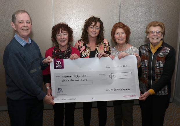 Pauline Ennis, Angela Hore and Mary Millar (centre) of the Wexford Women's Refuge accepting a cheque for €700 from Eric Duncan and Joan Dier of the Enniscorthy Active Retirement Association