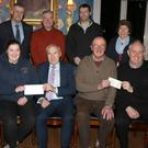 Enniscorthy Lions Club presentation of cheques to local charities. Back: Niamh Tierney, Jimmy Gahan, Stephen Mahon, Enda Furlong and Helen Kirwan. Front: Rev Nicola Halford, Patricia Byrne (Irish Pilgrimage Trust), Eric Barron (President Enniscorthy Chamber), Dessie Sheehan (St. Vincent de Paul) and Fr. Odhran Furlong.