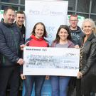 O'Neill's Dry Cure Bacon Company presentation of cheque for €2500 to Pieta House, proceeds of O'Neill's Piggy Bank annual donation to charities. Pictured are Pat and Mary O'Neill and their staff presenting cheque to Olive Ruane of Pieta House