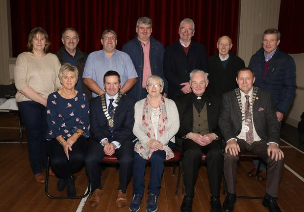 Rita McCabe, Willie Murphy, Andy Fenlon, Cllr. Oliver Walsh, Cllr. Pip Breen, George Dunbar and Denis Kinsella. Front: Ann Fenlon, Cllr.John Hegarty, Rose Breen, Fr. William Cosgrave and Cllr. Wilie Kavanagh at the re-opening of Monageer Hall following renovations