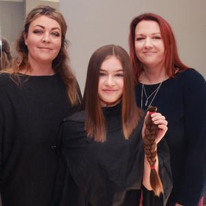 Faye Jordan, Bunclody, who had her hair cut and donated to the'Little Princess Trust' for young adults and children who need good quality wigs, pictured with her auntie and proprietor, Tara Baker (left) and her mother Lyndsey Jordan