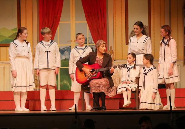 Emma Hore (Maria Rainer) and the Von Trapp children in 'The Sound of Music' in Oylegate Community Centre