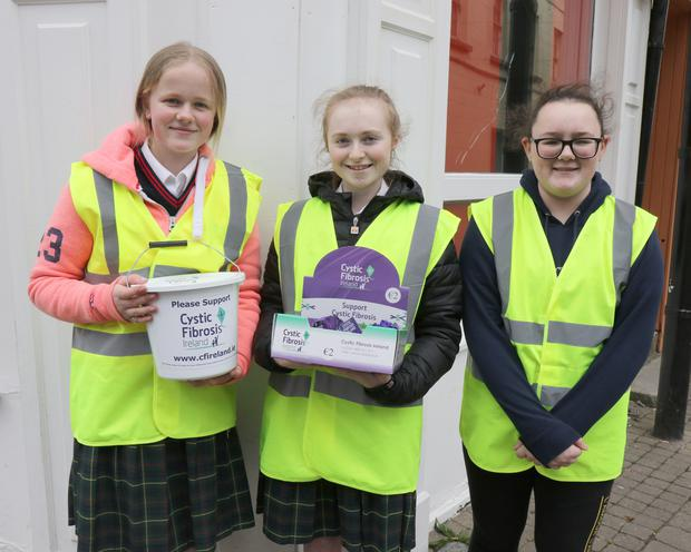 TY students, Niamh Lambert and Cayleigh O'Brien-Doyle (Colaiste Bride) and Lily Byrne (Enniscorthy VC) volunteering in the Market Square for Cystic Fibrosis Awareness Day