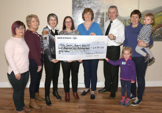 Mary O'Neill, Ellen Walsh, Janet Rothwell, Denise McDonald, Rose Clare, Sean McCarthy, Mynie Leech and Sophie and Alfie presenting a cheque for €2,630 to the Hope Centre