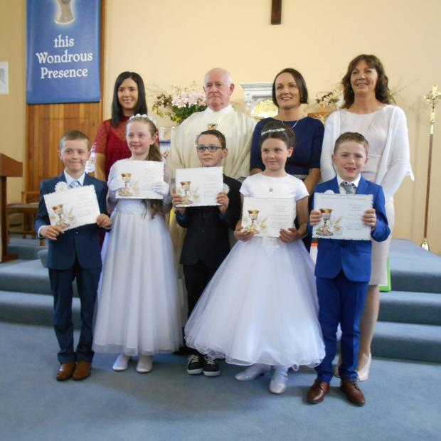 The Castledockrell National School first communion class, from left (back row)