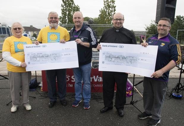Pat Mulvey, Mick Butler (Hope Cancer Support Centre), John O'Reilly (Rathnure Panto Society), Fr Martin O'Brien (ISCC) and Liam Sharkey (Rathnure Panto Society).