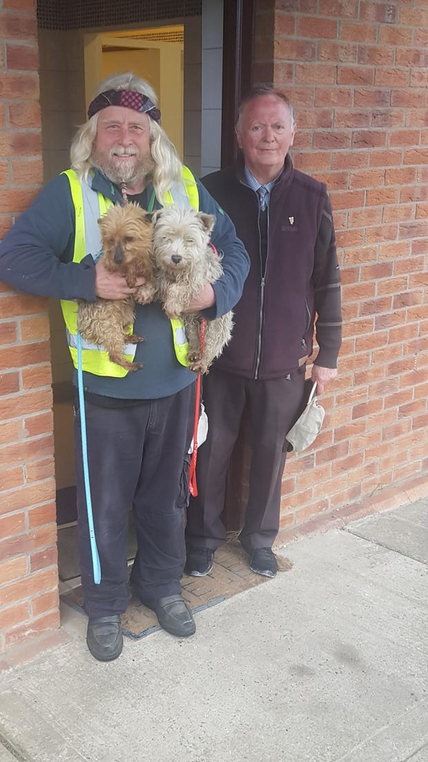 John Byrne (on right) pictured with Robert Doran, discovered the two dogs tied up in the disabled toilet of St Mary's Cemetery