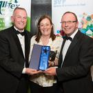 Orla Harrington is pictured accepting the award from Dermot McGilloway, SVP National Retail Development Manager (left), and Noel Cassidy, SVP South East Shops Area Manager. Picture: Alan Place.