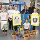 The Wildflower Girls, from Ballindaggin National School, were presented with gardening gear in Smyth's Hardware. Pictured,from left, are: Maeve Tobin, Eva Nolan, Jodi Pender, Aoife O'Gorman, Saoirse Delaney, with Betty and Dermot Kavanagh