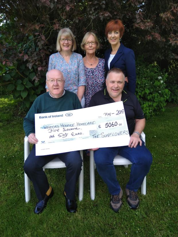 Pictured, from left, (back row): Maudie Maher, Evelyn Kinsella, Maura O'Leary; (Front row): Lar Kinsella and Eamonn Mernagh (accepting the cheque on behalf of Wexford Hospice Homecare)