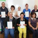 Back row: Ken Banville, Angela Brennan, Angela Connolly and Lar Murray. Front: Mary Burke, Myra Weafer and Mary Walsh (BTEI co-ordinator) at WWETB Part Time Learning Health Care Support Awards 2019 at Enniscorthy Further Education and Training Centre, Gonzaga House, Weafer Street