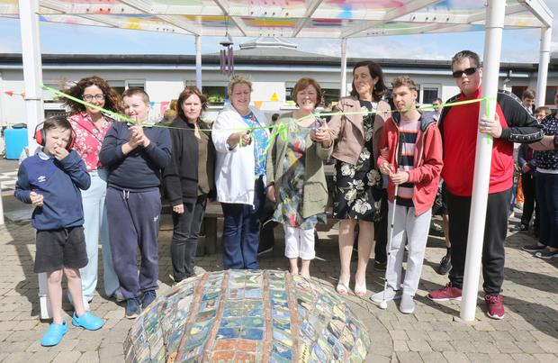 Teachers, parents and children at the official opening of St. Senan's Sensory Garden