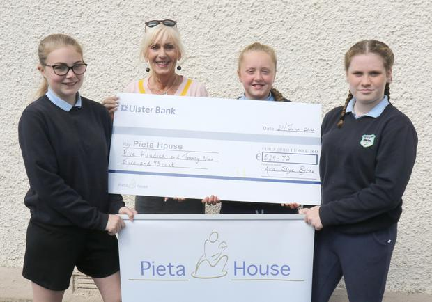 Ava Byrne presenting a cheque for €529.73 to Olive Ruane of Pieta House, proceeds of 'Hell & Back', with Mia Dreelan and Leah Stanton-Mernagh at Castledockrell NS