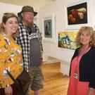Martina McShane, Brian Coleman and artist Noreen King-Urbin at the Ennsicorthy Art Trail in the Church Institute during the Rockin' Food Festival