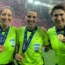 Michelle O'Neill (on the right) pictured with Manuela Nicolosi and Stephanie Frappart after creating history overseeing the Super Cup final