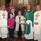 Mary Gannon with her husband Richard, sons Martin and Richard, grandchildren Adam and Grace, Bishop Denis Brennan, Fr Odhran Furlong and Fr Billy Swan