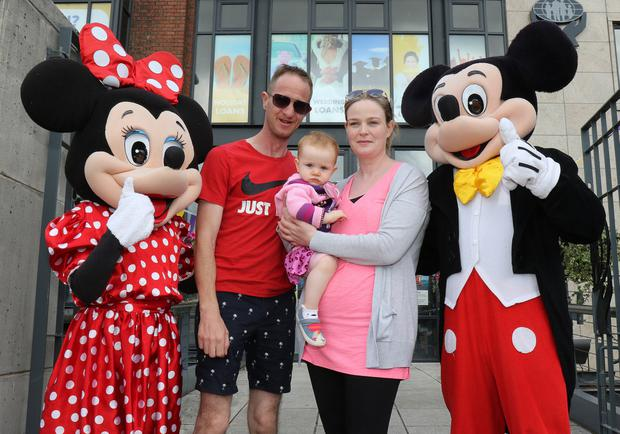 Natalie, Cali and Paddy Danagher with Minnie and Mickey Mouse at the Enniscorthy Credit Union Junior Members Day.