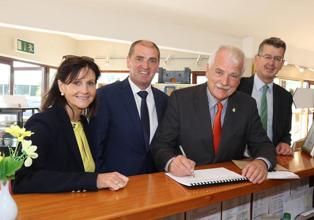 Jacqui Murphy (manager CWCW), Minister Paul Kehoe, Finian McGrath TD, signing visitors' book and Trevor Jacob (CEO CWCW)