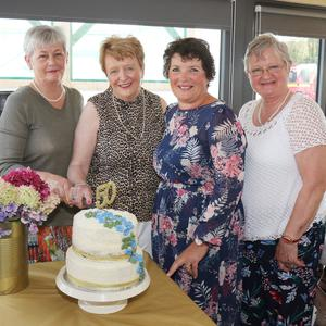Maggie Crean (present President), Eithne Cosgrave (first President), Mary D'Arcy (Federation President) and Mary Murphy (secretary), cutting the cake, at the Davidstown ICA Guild 50th anniversary dinner in Wheelock Fruits