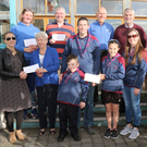 Enniscorthy Lions Club presenting cheques to 4 charities at Kilcannon Garden Centre, proceeds of annual Enniscorthy Lions Club Fun Cycle. In picture: Tina Kavanagh (Edermine Ferry Rowing Club and chairperson Gaelscoil Coiste), Stephen Mahon (treasurer ELC), Ben Bernie (ELC), Jimmy Gahan (ELC), Michael Bennett (ELC), Delores and Brónagh Lucas, Des and Cathal Wheelock (31st. Wexford Ballyhuskard Scouts), Doreen Moran (ELC) and Gillian Wilson (St. Mary's NS)