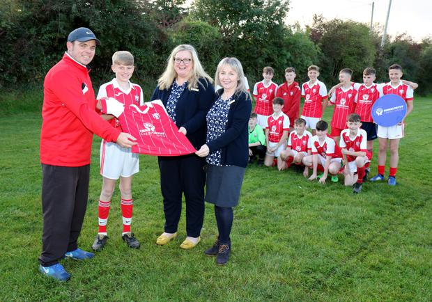 Moyne Rangers AFC under 15 team being presented with a new set of jerseys by Aine Doyle of sponsors Enniscorthy Credit Union. Willie Browne (manager), James Lawless (captain), Aine Doyle (Credit Union) and Sinead Browne (team mammy) and team