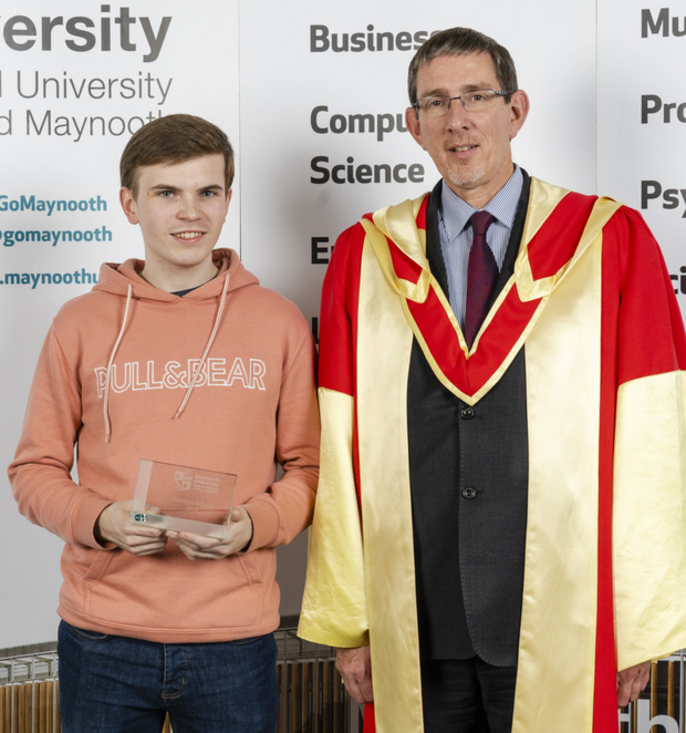 Jordan Rossiter accepting his scholarship to Maynooth University