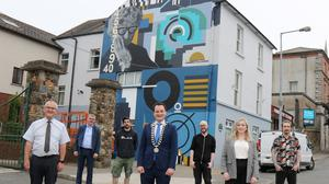 From left: Eugene Doyle and PJ Fielding from Doyle Fielding Charted Accountants; artist Omin; Cllr Cathal Byrne, chairman of Enniscorthy Municipal District; Larry Dunne, media and marketing manager for the project, Presentation Centre; Lisa Byrne, project manager, Presentation Centre; and Conor Gibson from the visual arts team at the Presentation Centre in front of the mural in Abbey Square that focuses on architect and designer Eileen Gray.