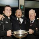 Captain Killian Lett, president Jim McCauley and former president Joe Smith celebrating the All-Ireland Junior Cup final victory at Enniscorthy Rugby Club on Saturday night