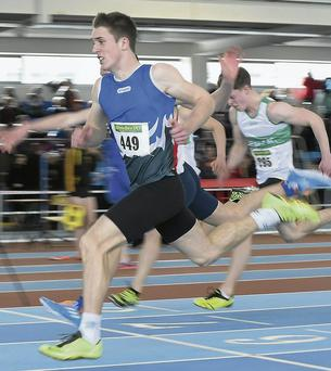 Ryan Murray, Bree AC, Wexford, crosses the line to win the U17 Boy's 60m Final at the Woodie's DIY Juvenile Indoor Track and Field Championships, Athlone Institute of Technology Arena, Athlone, Co. Westmeath