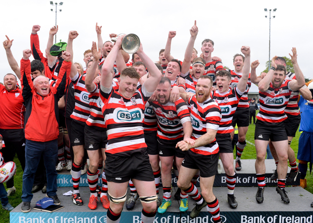 Tom Ryan of Enniscorthy RFC lifts the cup after the Bank of Ireland Provincial Towns Cup final match between Enniscorthy RFC and Wicklow RFC at Navan RFC