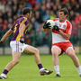 Graeme Molloy in action against Derry's Mark Lynch during his final inter-county Senior game in Owenbeg last July