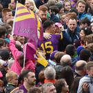 Paul Morris (15) works his way through the throngs of Wexford supporters after Saturday's sensational championship victory
