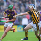 Conor McDonald taking on T.J. Reid during that memorable win against Kilkenny