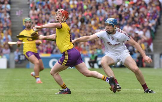 Wexford corner-back Willie Devereux ships a painful blow from Galway man of the match Conor Cooney in Sunday's Leinster SHC final. The focus switches to four more county teams who have vital knockout games this week