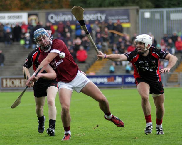 Des Mythen of Oulart-The Ballagh applies pressure on Conor Firman (St. Martin's) in their last final meeting two years ago