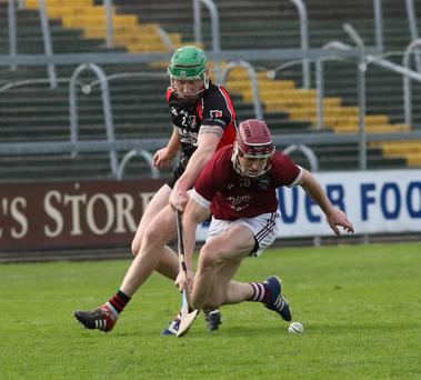 New Wexford Senior hurling recruit Jake Firman in a duel with Oulart-The Ballagh's Anthony Roche during Sunday's county final