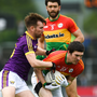 P.J. Banville tackling Conor Lawlor of Carlow on what proved to be his final Leinster Senior football championship game last May