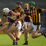 Rory O'Connor of Wexford in action against James Burke and Tommy Walsh of Kilkenny during the Bord Gais Energy Leinster GAA Hurling Under-21 championship final