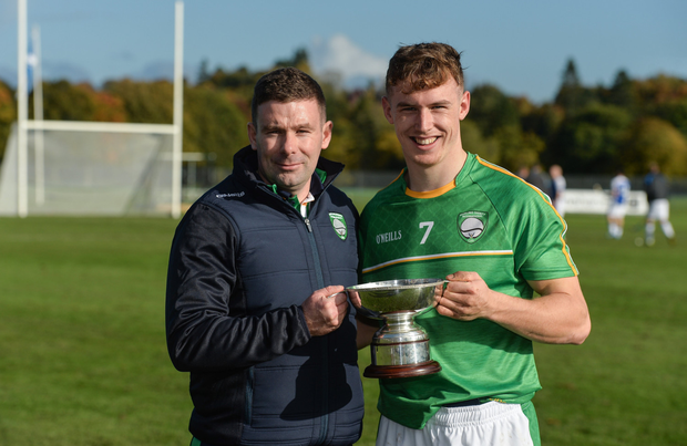 Cathal Dunbar (right) with fellow Wexfordman Willie Cleary (joint manager) after the pair were involved with Ireland's Under-21 hurling/shinty international win over Scotland in Bught Park, Inverness, last Octobe