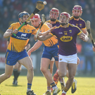 Lee Chin in the thick of the action with Clare's David McInerney before injury ruled him out of the second-half of Sunday's success
