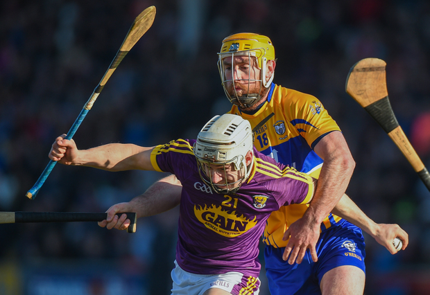 Cathal Dunbar trying to shake off Clare's Gearóid O'Connell after his introduction in the recent Allianz HL game in Innovate Wexford Park