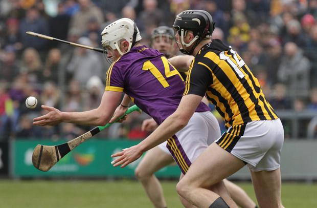 Rory O'Connor, the one bright light for Wexford, trying to get away from Kilkenny goal scorer Walter Walsh
