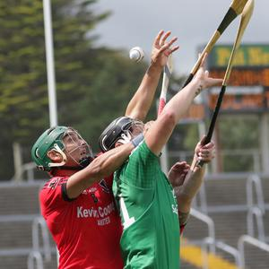Keith Rossiter of Oulart-The Ballagh challenges Conor McDonald of Naomh Eanna during their Pettitt's Senior hurling championship game