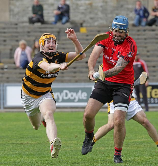 Dennis Morton of Oulart-The Ballagh clears under pressure from Rathnure's Shane Lawlor in Innovate Wexford Park on Sunday