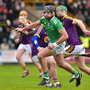 Colin Ryan of Limerick giving Wexford's Kevin Foley and Aidan Nolan the slip in Innovate Wexford Park on Sunday