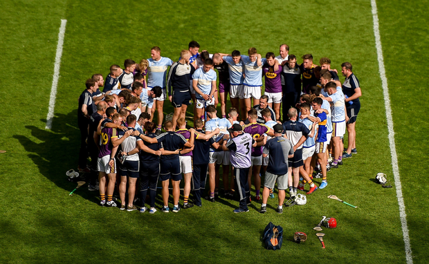 Wexford manager Davy Fitzgerald addresses his players on the field after Sunday's gut-wrenching All-Ireland semi-final defeat to Tipperary in Croke Park