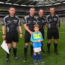 James Owens before the 2018 All-Ireland final with six-year-old Rian O'Connor, who presented him with the match ball, and his fellow officials Fergal Horgan (Tipperary), Seán Cleere (Kilkenny) and Patrick Murphy (Carlow) - referee for the Minor final between Galway and Kilkenny next Sunday.