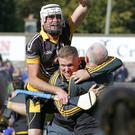 Centre-forward Patrick Naughter celebrates with manager John Nolan and selector Murt Kavanagh after the county final victory over Geraldine O'Hanrahans